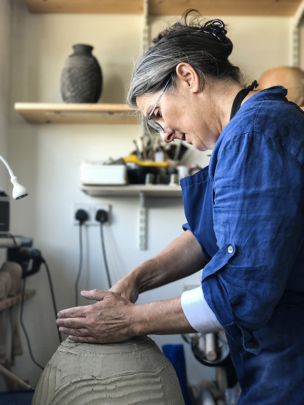 Patricia Shone working in studio