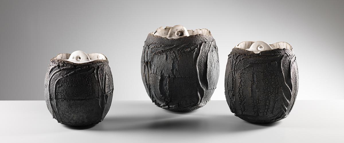 patricia-shone-ceramics-skye-3-lidded-erosion-jars.raku-fired-ht16cm.image-shannon-tofts