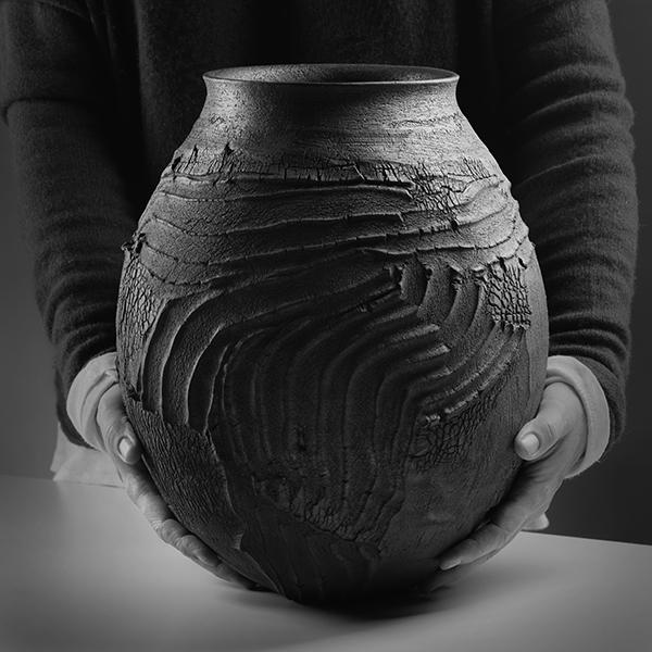 PatriciaShone.hands.ErosionJar32.raku fired.imageShannonTofts