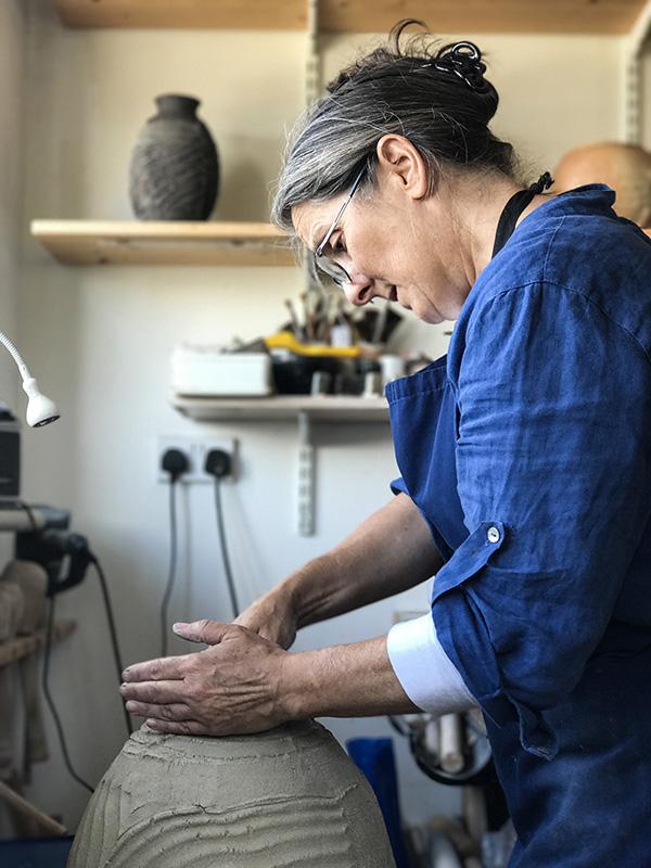 Patricia Shone working in studio
